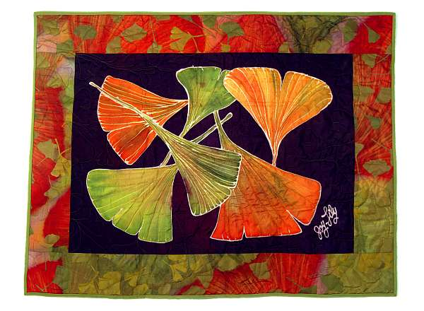 Silk quilt by Joy-Lily of gingko leaves on navy blue. Click to enlarge.