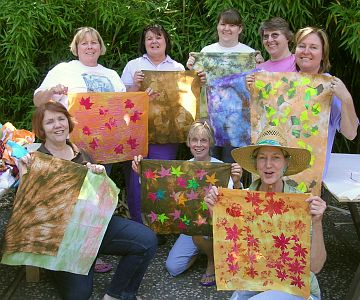 Group of women with leaf-design fabrics