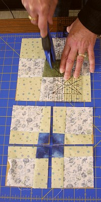 rotary cutting of Mary Lou's quilt squares