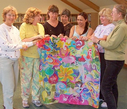 Silk painters hold up shared piece